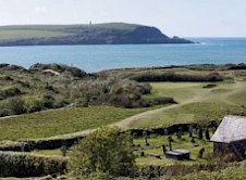 Panoramic view of 10th & 11th greens and St Enodoc Church