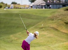 Alex Peters playing to the 18th green