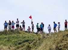 Volunteer marshal surrounded by spectators