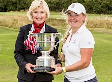 Bronte Law receiving the Trophy from England Golf Immediate Past President Pam Benka